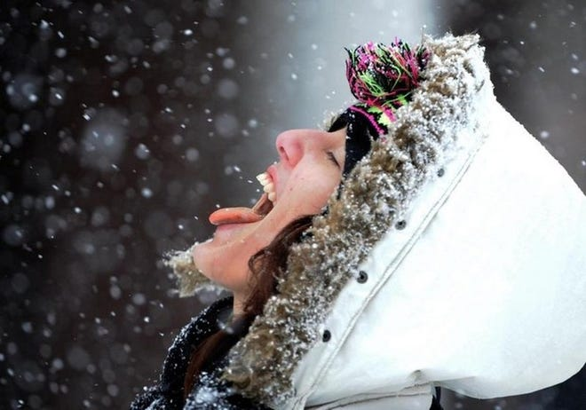 A tile photo of a someone catching snowlfakes with their tongue. Reno forecasters expect a cold front to bring gusty winds, cold temperatures and snowfall to the Reno-Tahoe region this weekend.