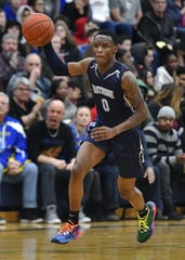 Eastridge's Tony Arnold dribbles up the court during a regular season game at Irondequoit High School, Wednesday, Jan. 29, 2020. Irondequoit beat Eastridge 75-59.