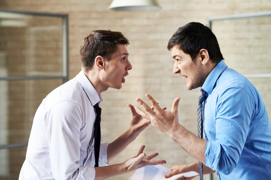 Two men arguing at office.