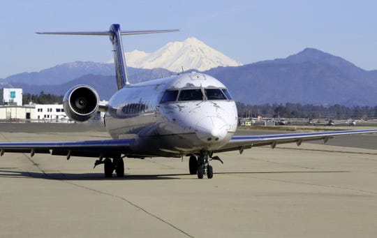 A United Airlines flight waits to take off from Redding Municipal Airport on Friday, Jan. 31, 2020.