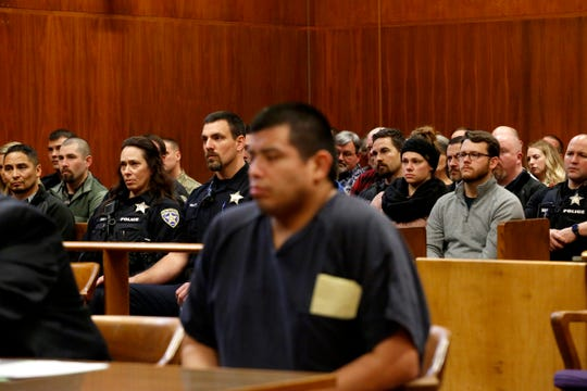 About 50 uniformed police officers and others fill a Marion County courtroom on Jan. 31, 2020 as Jaime Lee Jimenez, 39, of Salem, is sentenced to more than 28 years in prison for shooting Salem Police Officer Michelle Pratt, seated at left with her husband Salem Police Sgt. Jacob Pratt.