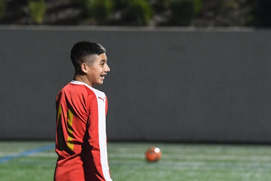 Vasquez laughs with a teammate during a practice game for ECFC's Real Madrid 2006 boys team. Jan. 29, 2020.