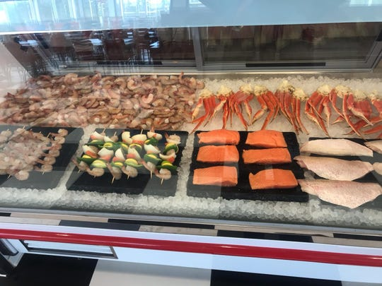 The seafood display case at Flying Burger & Seafood.