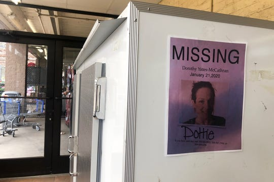 "A flyer of missing 40-year-old Dorothy Yates-McCathran, also known as ""Dottie,"" is seen taped to the side of an ice cooler at the Walmart in Vivian on Jan. 31, 2020."