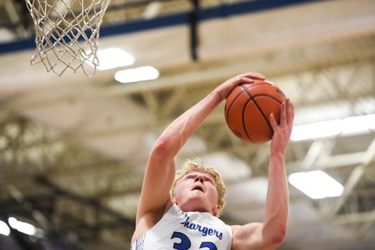 Sioux Falls Christian's Zach Witte (33) rebounds the ball during the game against Dakota Valley on Thursday, Jan. 30, 2020 at Sioux Falls Christian High School.