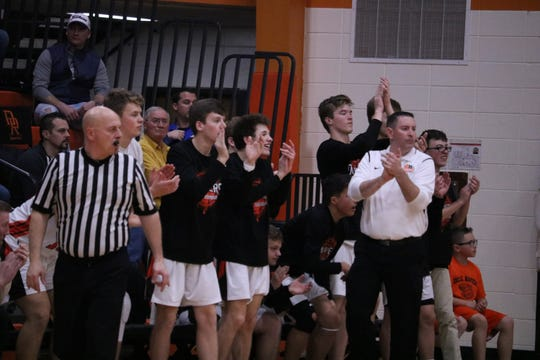 Head coach Jason Fersdahl and the Dell Rapids bench cheer during a game against Vermillion on Thursday, Jan., 30.