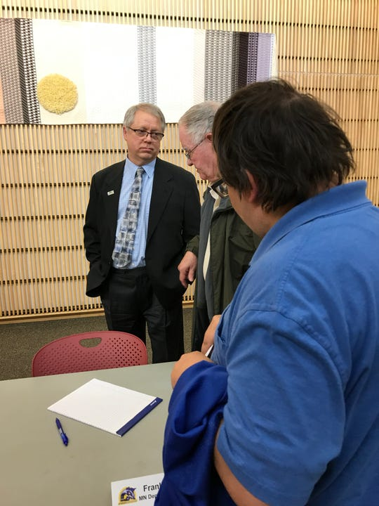 Frank Loetterle, supervisor in Minnesota's freight and railway planning unit, visits with attendees at a Northstar town hall at the Great River Regional Library in St. Cloud on Thursday, Jan. 30, 2020.