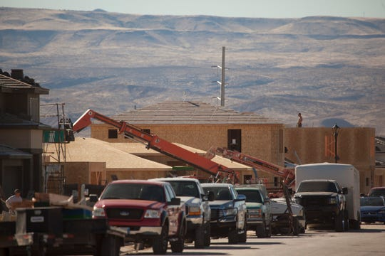 Construction crews work in the Sage Canyons area of St. George on Thursday, Jan. 30, 2020. New homes and other buildings are popping up out of the desert in the southeast corner of St. George, where hundreds of acres of new development is expected to move in over the next 10 years.