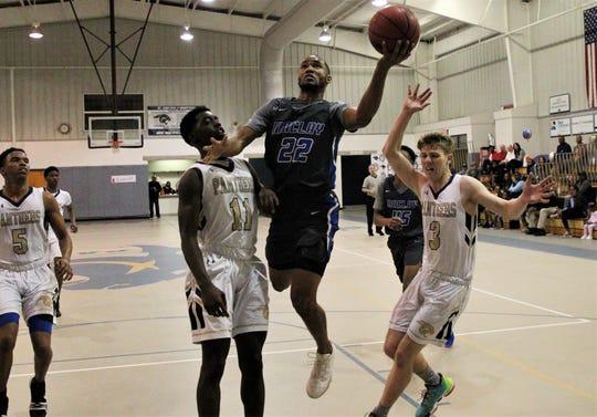Maclay senior Robert Parker-Crawford drives for a layup as St. John Paul II's basketball team beat Maclay 53-51 on senior night, Jan. 30, 2020.
