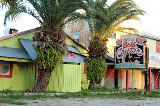 Boss Oyster, one of the landmark Apalachicola dining spots, is among the properties being marketed. [
