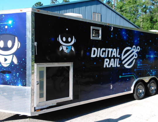 An exterior image of TCC's Digital Rail, a 26-foot mobile unit equipped with the latest technologies used to expose students  to robotics, cyber security and 3-D printing.