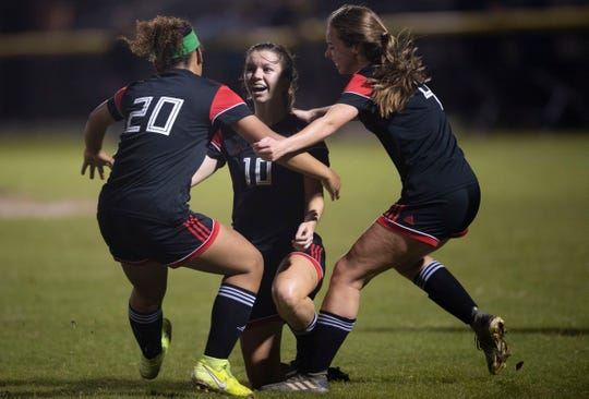 Vero Beach High School's Madelaine Rhodes celebrates scoring a goal as the Lady Indians faced Dwyer High in the District 9-7A girls soccer championship Thursday, Jan. 30, 2020, at South County Regional Stadium in Port St. Lucie. Vero Beach won 4-2.