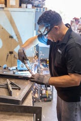 TAMCO employee Jose Checo welds a frame at the company's new Port St. Lucie manufacturing and warehouse facility.