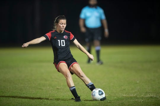 Vero Beach High School's Madelaine Rhodes kicks the ball in to score a goal as the Lady Indians faced Dwyer High in the District 9-7A girls soccer championship Thursday, Jan. 30, 2020, at South County Regional Stadium in Port St. Lucie. Vero Beach won 4-2.