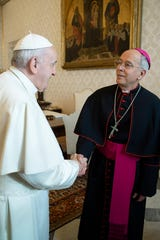 Pope Francis and El Paso Diocese Bishop Mark J. Seitz shake hands during their meeting Jan. 20, 2020, at the Vatican.