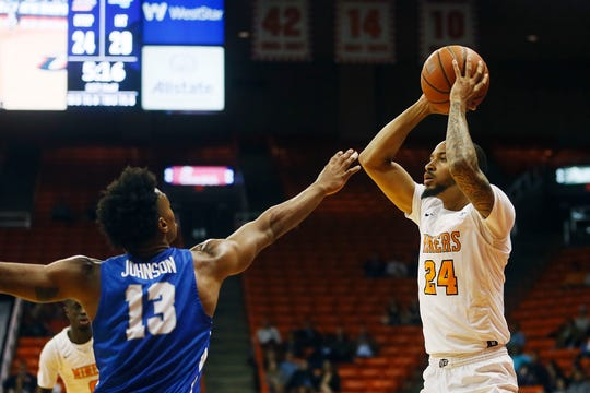 UTEP's Daryl Edwards goes against Middle Tennessee's Jayce Johnson during the game Thursday, Jan. 30, at the Don Haskins center in El Paso.