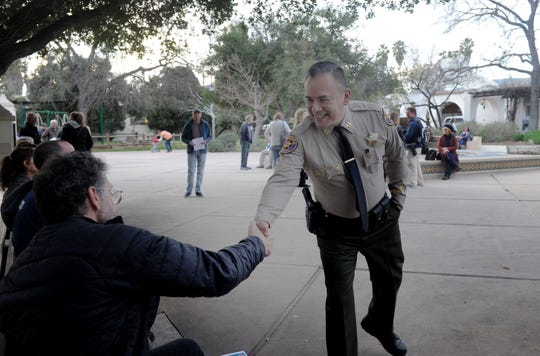 Larry Steingold, left, shakes hands with Capt. Jose Rivera, Ojai chief of police, during a recent event in the city.