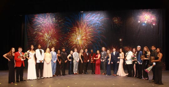 Bobby Williams, Mr. Millville 2020, (fourth from right) is joined by his escort and the other contestants and their escorts at the conclusion of the contest.