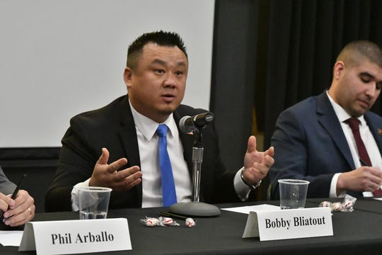 Democratic candidate Bobby Bliatout speaks during a U.S. House of Representatives CA-22 forum Thursday night at  College of the Sequoias' Ponderosa Hall in Visalia.