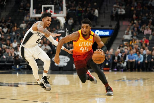 Jan 29, 2020; San Antonio, Texas, USA; Utah Jazz guard Donovan Mitchell (45) drives past San Antonio Spurs guard Dejounte Murray (5) in the first half at the AT&T Center. Mandatory Credit: Daniel Dunn-USA TODAY Sports