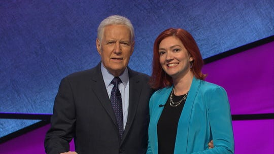 """Jeopardy!"" contestant Michelle Paul of Newark with host Alex Trebek. Paul won Thursday's episode with $17,900."