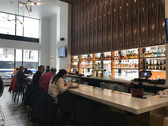Patrons enjoy lunch at the bar at DECO