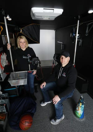 Jessica Tysinger and her husband Shane run Power Portraits. In addition to a studio in their Blue Rock home, they have a heated and air conditioned mobile portrait studio to do sports team pictures.