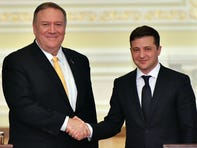 U.S. Secretary of State Mike Pompeo and Ukraine's President Volodymyr Zelensky shake hands as they address the media following their meeting in Kyiv on Jan. 31, 2020.