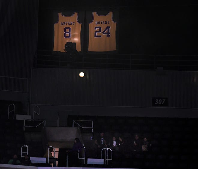 Kobe Bryant's Lakers jerseys remain illuminated during Thursday's Clippers game at Staples Center.