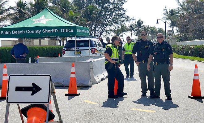 Palm Beach Police and Palm Beach County Sheriff's deputies have set up a check point at the intersection of S. County Rd. and S. Ocean Blvd. Friday in Palm Beach.