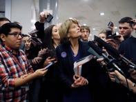 Sen. Lisa Murkowski, R-Alaska, talks with reporters as in the basement of the U.S. Capitol in Washington, Thursday, Jan. 30, 2020, while leaving at the end of a session in the impeachment trial of President Donald Trump on charges of abuse of power and obstruction of Congress.