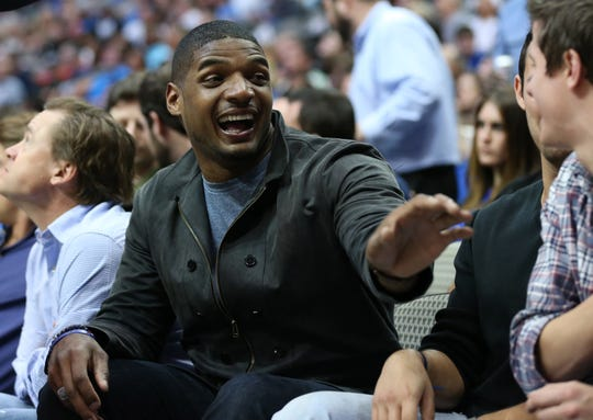 Feb 28, 2016; Dallas, TX, USA; Michael Sam sits courtside to watch the Dallas Mavericks play against the Minnesota Timberwolves at American Airlines Center.