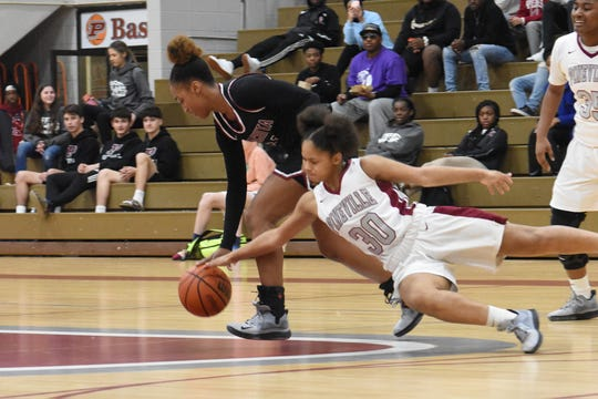 Pineville's Morgan Kendricks (30) and Ouachita's Tia Perry (14) battle for a loose ball Friday, Jan. 31, 2020. Ouachita won 56-44.
