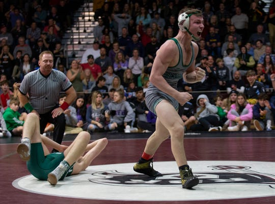 Colts Neck's Logan Waller (right) exults after he pinned Long Branch's Ryan Zimmerman in the 138-pound championship bout of the Shore Conference Tournament. Referee John Fiorentino is in the upper left.