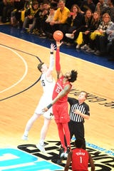 """Super Saturday"" at Madison Square Garden on Saturday, February 1, 2020. Rutgers and Michigan compete in wrestling and men's basketball. R #15 Myles Johnson and M #15 Jon Teske during the opening tip off."