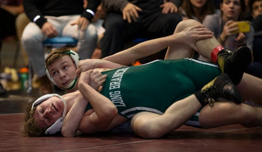 Colts Neck's Logan Waller (right) scored back points in the second period of the 138-pound championship bout of the Shore Conference Tournament. Waller pinned in the third period.