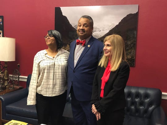 Neptune resident Joanne Atkins-Ingram (left), whose son, Braeden Bradforth died of heatstroke playing football at a Kansas junior college, with Avon attorney Jill Elaine Greene (right), with New Jersey Rep. Donald Payne Jr.  last week in  Washington, D.C.