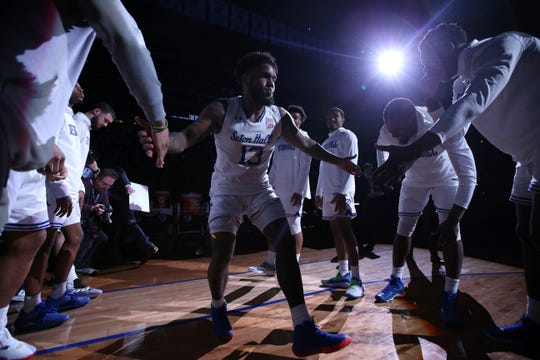 Seton Hall's Myles Powell (13) enters the arena before the start of the first half of an NCAA college basketball game against Xavier, Saturday, feb. 1, 2020, in Newark, N.J. (AP Photo/Michael Owens)