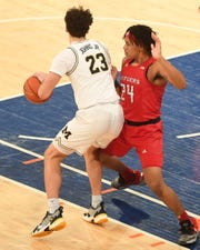 """""""Super Saturday"""" at Madison Square Garden on Saturday, February 1, 2020. Rutgers and Michigan compete in wrestling and men's basketball. R #24 Ron Harper Jr. defends against M #23 Brandon Johns Jr. in the first half."""