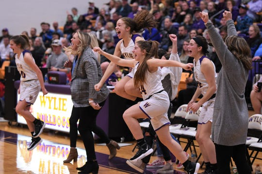 The Wylie bench reacts to beating Cooper 38-33 at Bulldog Gym on Friday, Jan. 31, 2020. It was the fourth-straight District 4-5A win for the Lady Bulldogs.