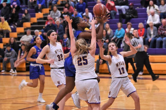 Cooper's Dazz Larkins (23) goes up over Wylie's Makinlee Bacon (25) for a shot at Bulldog Gym on Friday, Jan. 31, 2020. The Lady Cougars fell 38-33.