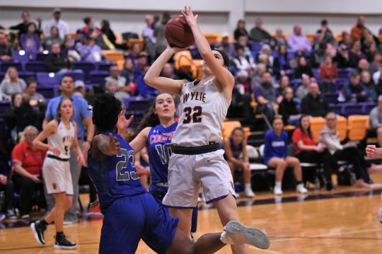 Wylie's Kenyah Maroney (32) goes up for a shot against Cooper at Bulldog Gym on Friday, Jan. 31, 2020. The Lady Bulldogs won 38-33 for their fourth-straight District 4-5A win.