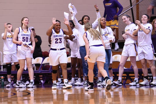 Hardin-Simmons' Jesyka Lee (23) waits to give Hallie Edmondson (2) a high-five after a steal to end the first half against No. 13 Mary Hardin-Baylor at the Mabee Complex on Saturday. Edmondson's steal led to a basket for a 38-32 lead at halftime of the 67-64 victory.