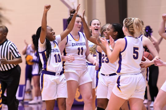 HSU's Taylor Gaffney (10), Keilee Burke (11), Jesyka Lee (23) and Brittany Schnabel (5) celebrate their 67-64 win against No. 13 Mary Hardin-Baylor at the Mabee Complex this season. Gaffney is playing her final two regular season games this week at Texas-Dallas and Ozarks before the ASC tournament begins.
