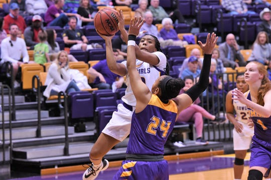 Hardin-Simmons guard Taylor Gaffney (10) goes up for a contested shot against No. 13 Mary Hardin-Baylor earlier this season. Gaffney reached the 1,000-point mark for her career on Feb. 13 at Howard Payne.
