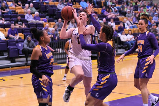 Hardin-Simmons' Keilee Burke (11) goes up for a shot against No. 13 Mary Hardin-Baylor at the Mabee Complex on Saturday. The Cowgirls won 67-64 to claim first place in the ASC West.