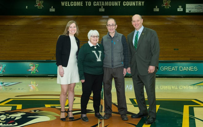 UVM women's basketball coach Alisa Kresge, left, and athletic director Jeff Schulman pose with Betty and Paul Mayer of Shelburne.  The Mayers donated an undisclosed amount to the women's hoops program, endowing the head coach position.
