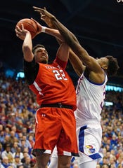 Feb 1, 2020; Lawrence, Kansas, USA; Texas Tech Red Raiders forward TJ Holyfield (22) shoots against Kansas Jayhawks center Udoka Azubuike (35) during the first half at Allen Fieldhouse. Mandatory Credit: Jay Biggerstaff-USA TODAY Sports