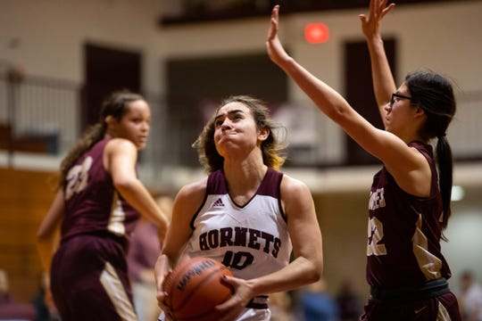 Flour Bluff's Bella Bertero drives the ball to the basket during the third quarter of their game against Tuloso-Midway at Flour Bluff on Friday, Han. 31, 2020.