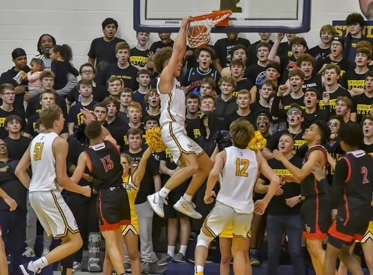 Max Land of Moeller dunks the ball against La Salle at Moeller High School, Friday, Jan. 31, 2020
